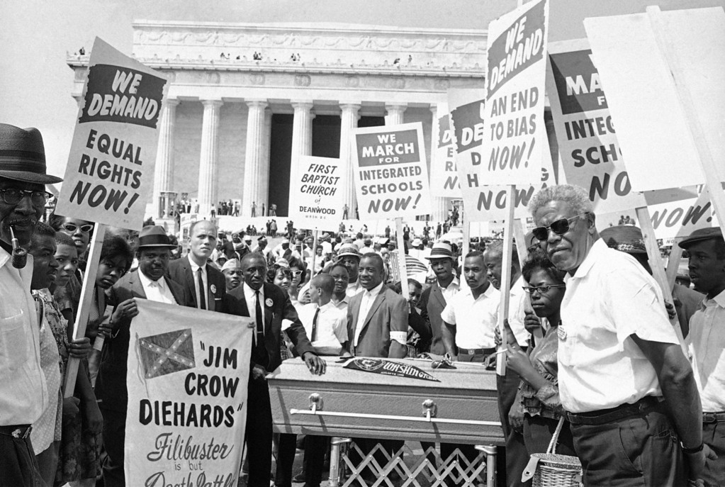 . Group of demonstrators stand around casket at Lincoln Memorial in Washington, August 28, 1963. The group carried placards as they pushed the casket down Constitution Avenue during the March on Washington parade. (AP Photo)