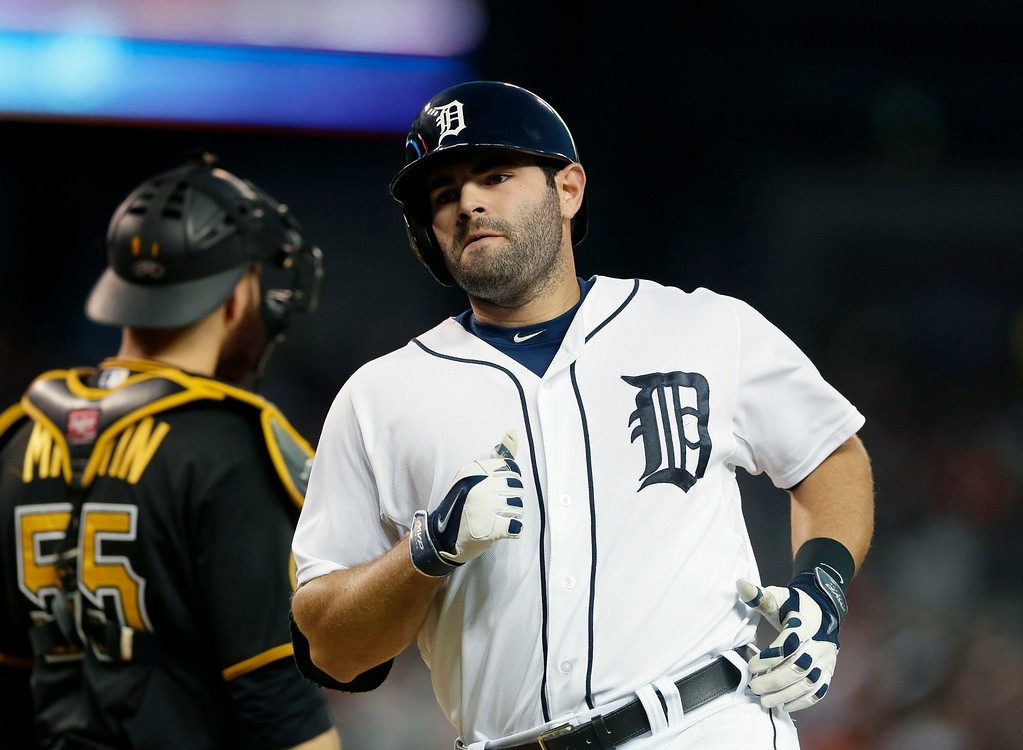 . Detroit Tigers\' Alex Avila reaches home plate after his solo home run during the fifth inning of an interleague baseball game against the Pittsburgh Pirates, Wednesday, Aug. 13, 2014 in Detroit. (AP Photo/Carlos Osorio)