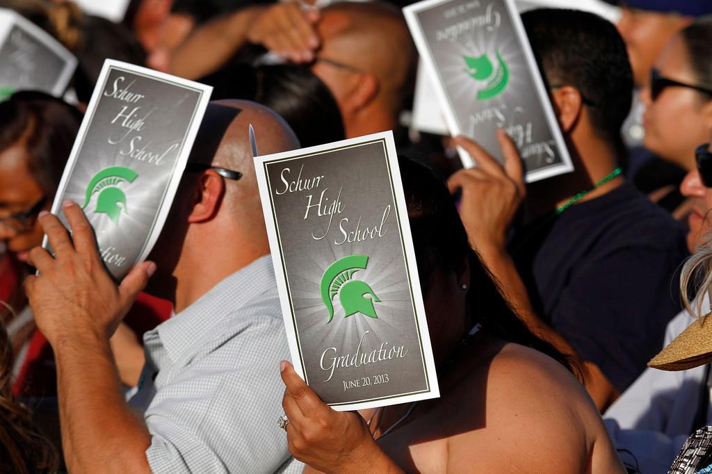 . Guests shade themseleves during Schurr High School 2013 Commencement Exercises, at Ken Davis Field, at Schurr High School in Montebello, Thursday, June 20, 2013. (Correspondent Photo by James Carbone/SWCITY)