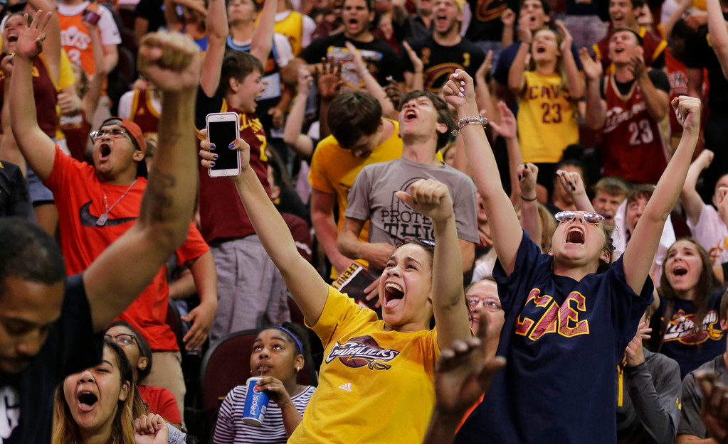 . Cleveland fans react during a watch party at Quicken Loans Arena during Game 5 of basketball\'s NBA Finals between the Golden State Warriors and the Cleveland Cavaliers, Monday, June 12, 2017, in Cleveland. (AP Photo/Tony Dejak)