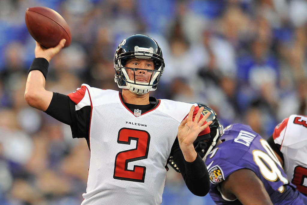 . Atlanta Falcons quarterback Matt Ryan passes under pressure from Baltimore Ravens defensive tackle Chris Canty during the first half of a preseason NFL football game in Baltimore, Thursday Aug. 15, 2013. (AP Photo/Gail Burton)