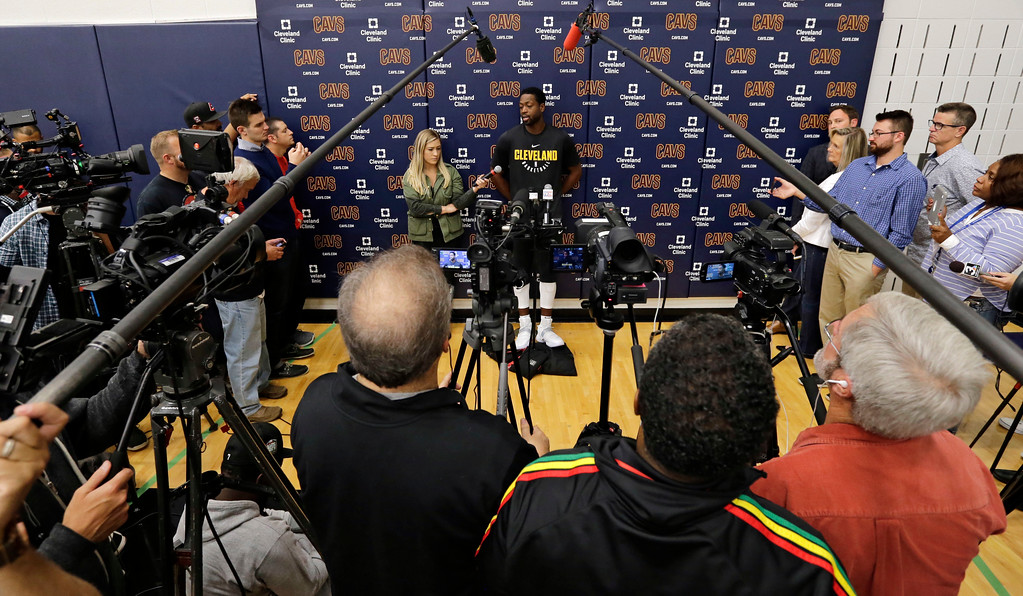 . Cleveland Cavaliers\' Dwyane Wade, center, answers questions during a news conference at the NBA basketball team\'s training facility, Friday, Sept. 29, 2017, in Independence, Ohio. Wade once convinced LeBron James that Miami was the place to be. Seven years later, James lured Wade to Ohio for the chance to win another NBA title, together. (AP Photo/Tony Dejak)