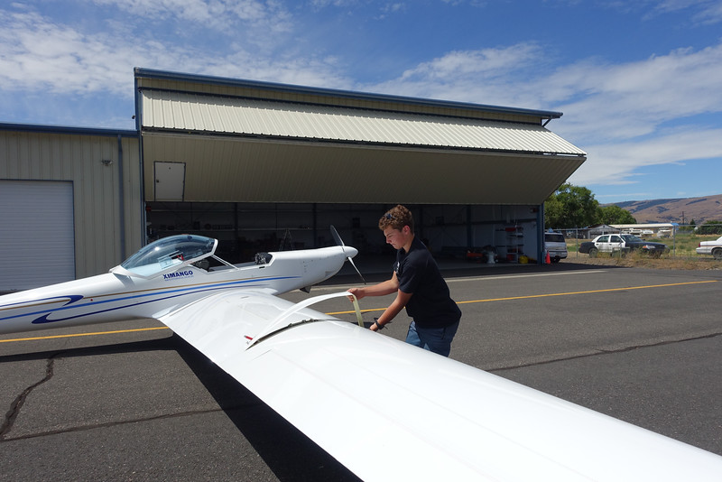 Ethan continues the assembly of the Ximango on day 2 of flying.