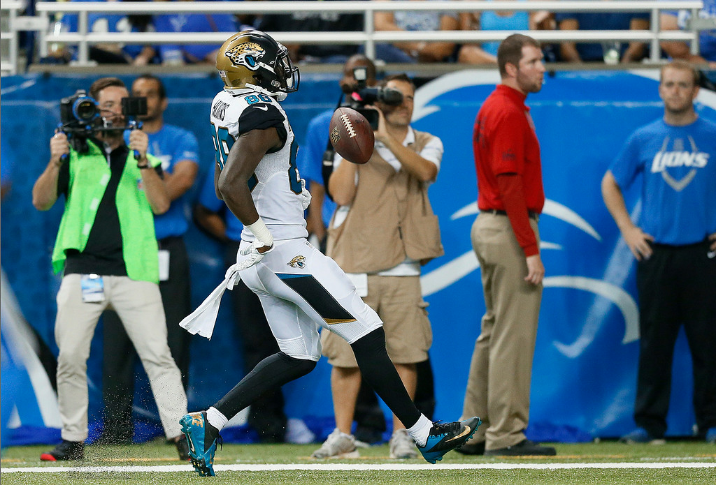 . Jacksonville Jaguars wide receiver Allen Hurns (88) celebrates his 13-yard touchdown reception from Blake Bortles against the Detroit Lions in the second half of a preseason NFL football game at Ford Field in Detroit, Friday, Aug. 22, 2014. (AP Photo/Rick Osentoski)