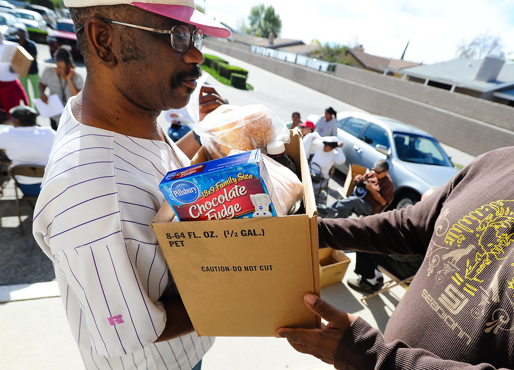 . Rodolfo Talavera receives a free Thanksgiving dinner basket at 16th Street Seventh-day Adventist Church in San Bernardino on Tuesday, Nov. 26, 2013. The church distributed 175 baskets to families-in-need. (Photo by Rachel Luna / San Bernardino Sun)