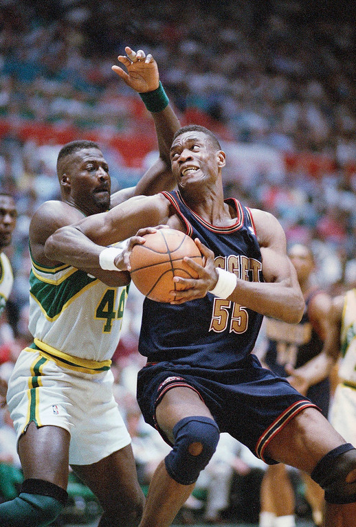 . 1991: Dikembe Mutombo (No. 4 overall) Dikembe Mutombo (55) of the Denver Nuggets spins around Michael Cage of the Seattle SuperSonics during the third quarter of their NBA playoff game in Seattle on Thursday night, April 28, 1994. Seattle beat Denver 106-82. (AP Photo/Gary Stewart)