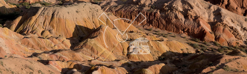 """aerial image showing a valley in the badlands of red sandstone landscape at the """"Fairy tale canyon"""""""
