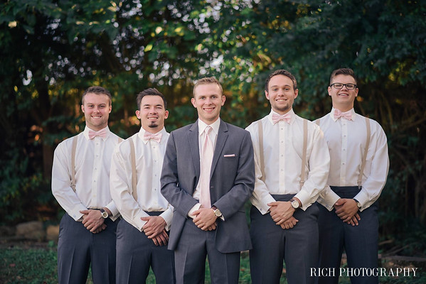 groomsmen and groom at farm wedding venue.jpg