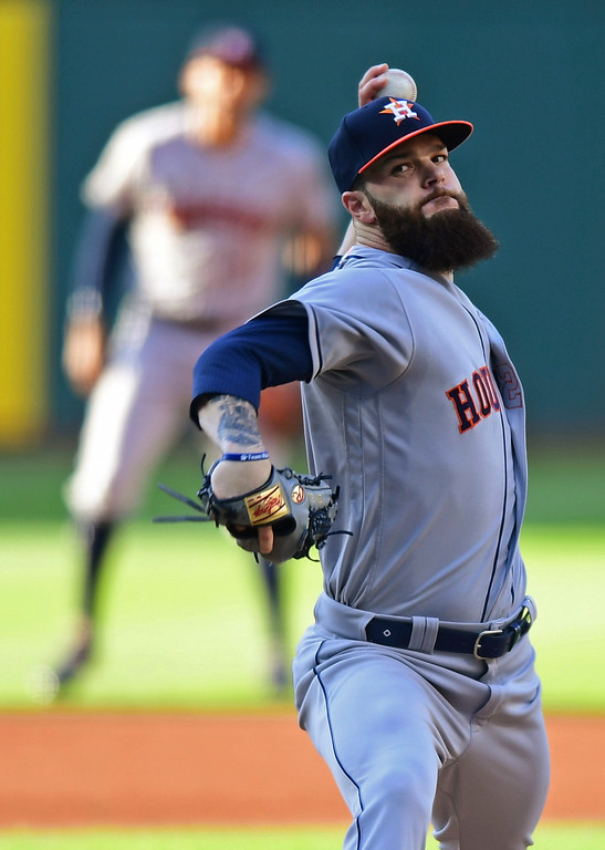 . Houston Astros starting pitcher Dallas Keuchel delivers during the first inning of the team\'s baseball game against the Cleveland Indians, Friday, May 25, 2018, in Cleveland. (AP Photo/David Dermer)
