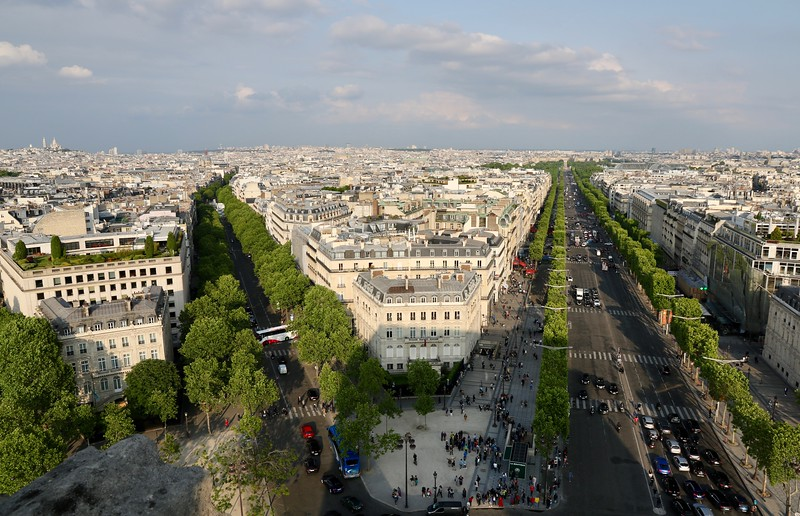 Looking down the Champs-Élysées from the top of the Arc de Triomphe (notice Sacre Coeur sitting atop the hill on the far left)