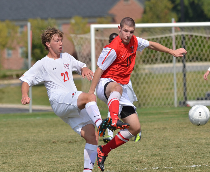 Riley Shelton (27) plays hard to try to get the ball from his opponent.