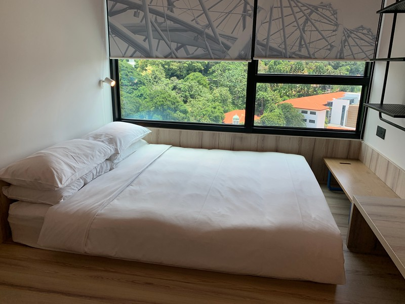 This photo has a bed but you don't get one for SINGAPORE WORKSPACE PACKAGE