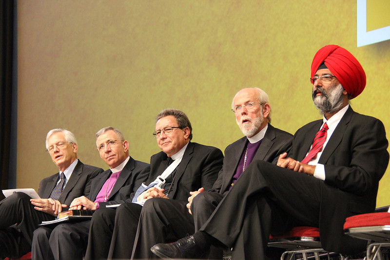 David Swartling, Bishop Munib Younan, the Rev. Donald McCoid, Presiding Bishop Mark S. Hanson and Dr. Tarunjit Singh Butalia are on stage during the Assembly.