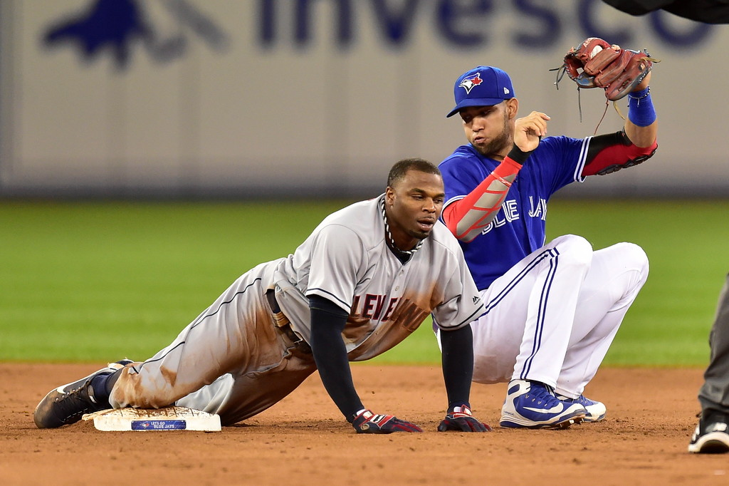 . Cleveland Indians\' Rajai Davis (26) is safe at second as Toronto Blue Jays second baseman Devon Travis looks at him during the ninth inning of a baseball game Friday, Sept. 7, 2018, in Toronto. (Frank Gunn/The Canadian Press via AP)