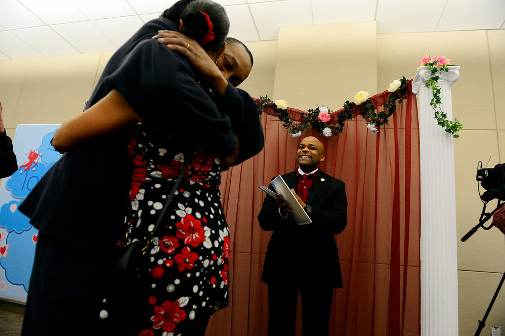 . DENVER, CO - FEBRUARY 14: Mayor Michael Hancock claps after marrying Delani Eugene Simmons and Lavette Michelle Noel during a Valentine\'s Day marriage celebration at the Denver Clerk and Recorder\'s office. Couples applying for marriage licenses received gift bags containing gift certificates to local restaurants among other treats to celebrate their union. (Photo By AAron Ontiveroz/The Denver Post)