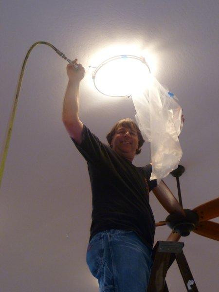 Robert cleaning lights.jpg