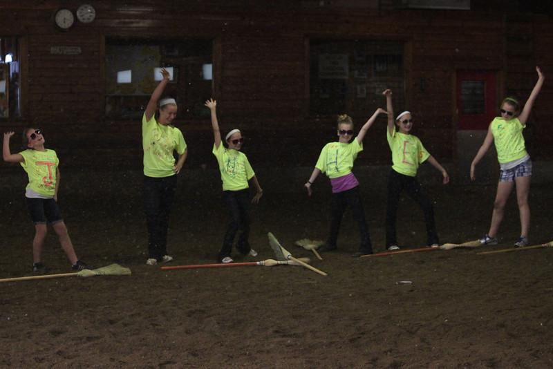 Team Friday ending their synchronized broom dancing performance. Photograph courtesy of Lisa Homa.