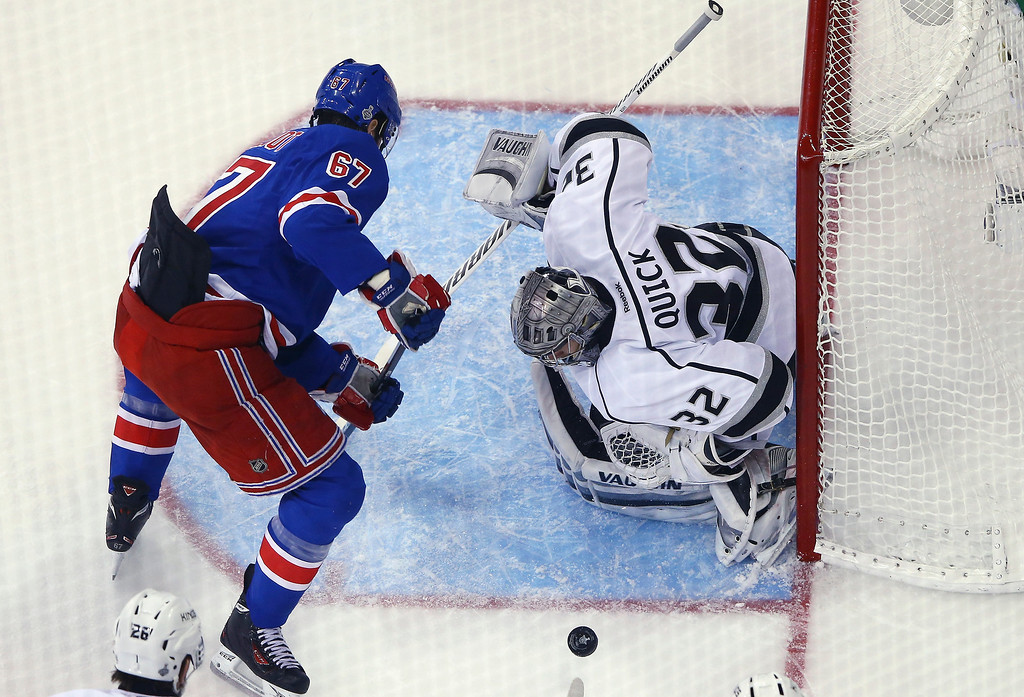 . Jonathan Quick #32 of the Los Angeles Kings makes a save on Benoit Pouliot #67 of the New York Rangers during the second period of Game Three of the 2014 NHL Stanley Cup Final at Madison Square Garden on June 9, 2014 in New York, New York.  (Photo by Al Bello/Getty Images)