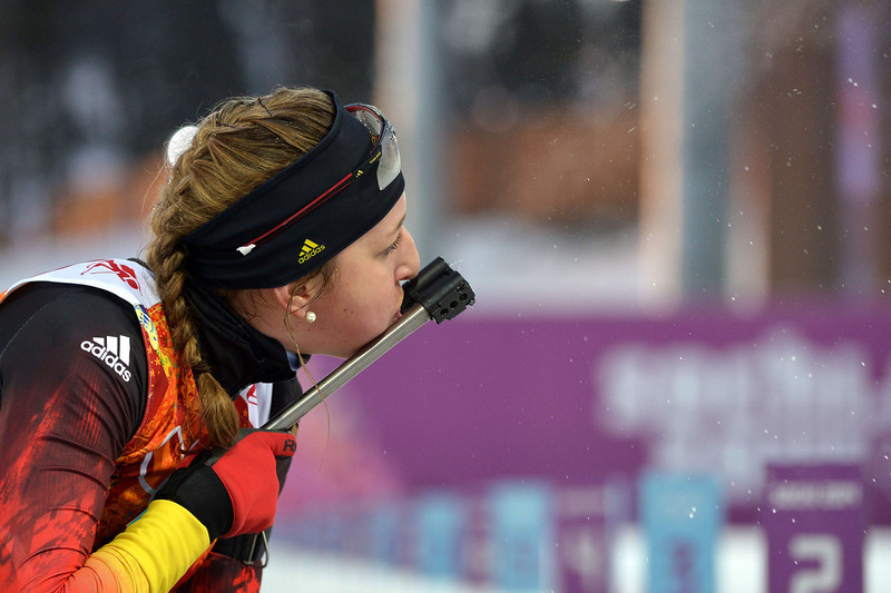. Germany\'s Franziska Preuss checks the sight of her rifle as she competes at the shooting range in the Women\'s Biathlon 4x6 km Relay at the Laura Cross-Country Ski and Biathlon Center during the Sochi Winter Olympics on February 21, 2014, in Rosa Khutor, near Sochi.  (ALBERTO PIZZOLI/AFP/Getty Images)