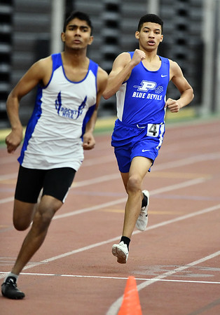 2/1/2020 Mike Orazzi | StaffrPlainville's Jeremy Courtar in the 600 meter run during the CCC Indoor Track & Field Championships at the Floyd Little Athletic Center in New Haven on Saturday.