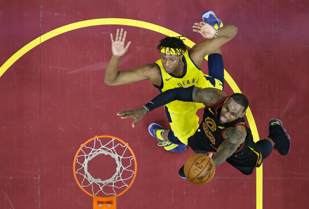 . Cleveland Cavaliers\' LeBron James drives to the basket against Indiana Pacers\' Myles Turner in the first half of Game 5 of an NBA basketball first-round playoff series, Wednesday, April 25, 2018, in Cleveland. The Cavaliers won 98-95. (AP Photo/Tony Dejak)
