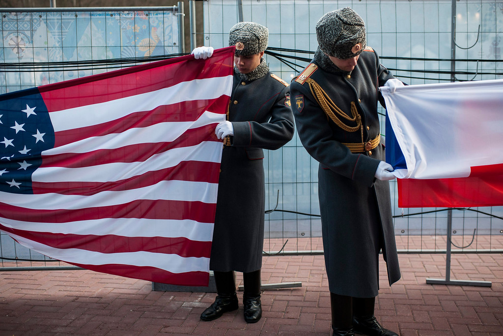 . Russian soldiers prepair the flags of the USA (L) and Russia during a medal ceremony at the Winter Paralympics 2014 Sochi in Krasnaya Polyana, Russia, on March 9, 2014.  EPA/ENNIO LEANZA