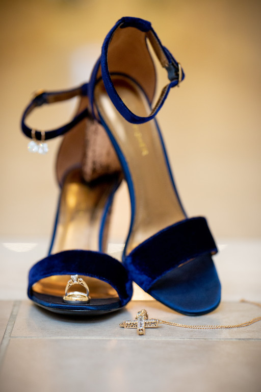 blue wedding heals with gold wedding and engagment rings