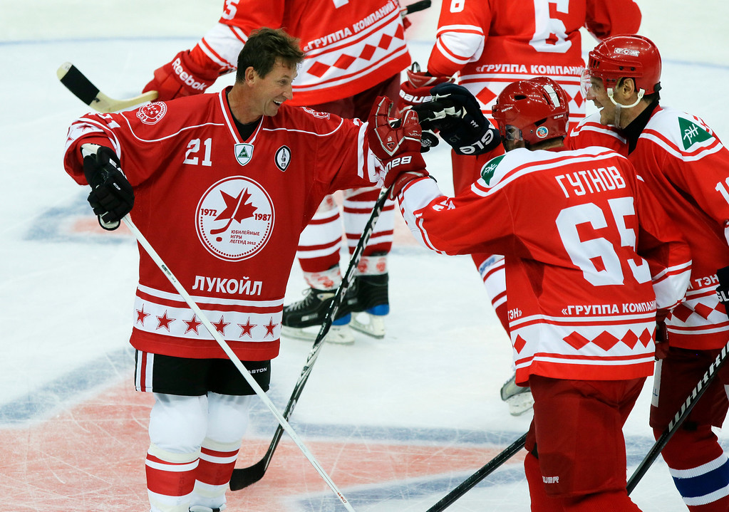 . Wayne Gretzky, left, reacts during a Legends\' Jubilee Games 2012 match between team Legend of Hockey and St. Petersburg\'s SKA veterans team in St. Petersburg, Russia, Wednesday, Sept. 5, 2012. (AP Photo/Dmitry Lovetsky)