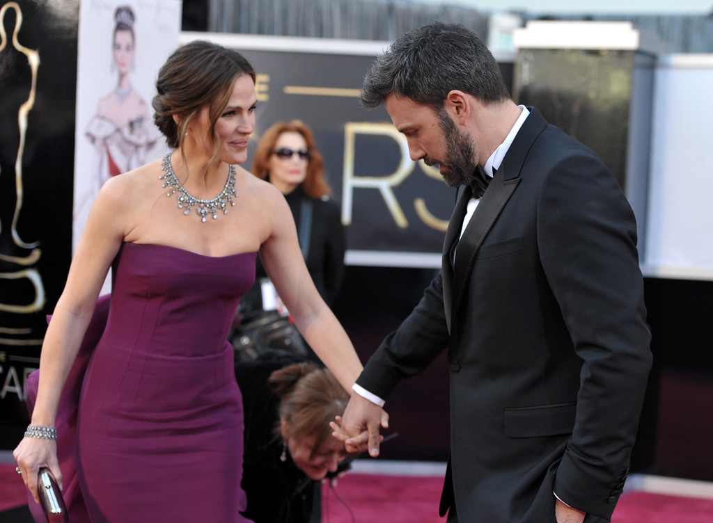 . Actors Jennifer Garner, left, and Ben Affleck arrive at the Oscars at the Dolby Theatre on Sunday Feb. 24, 2013, in Los Angeles. (Photo by John Shearer/Invision/AP)