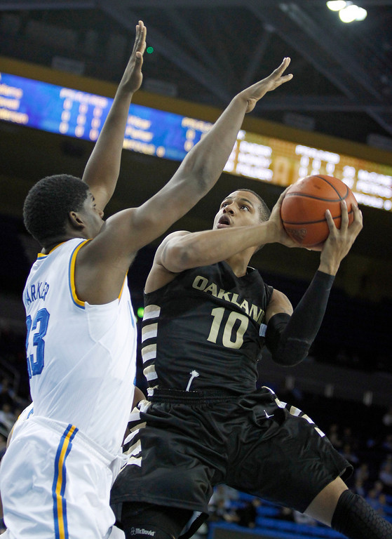 . Oakland guard Duke Mondy (10) shoots over UCLA center Tony Parker (23) during the first half of an NCAA college basketball game Tuesday, Nov. 12, 2013, in Los Angeles. (AP Photo/Alex Gallardo)