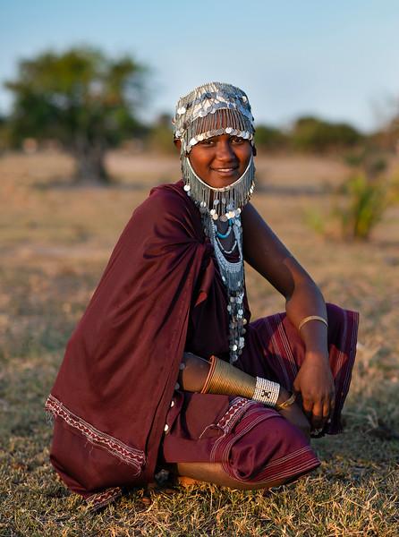 Portrait of a young Masai woman wearing traditional headgear.  Tanzania, 2019.