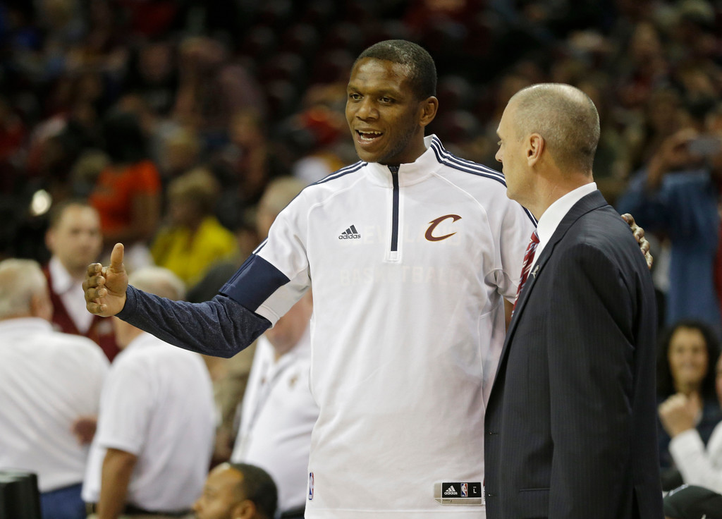 . Cleveland Cavaliers\' James Jones talks with Dallas Mavericks head coach Rick Carlisle before the start of the second half of a preseason NBA basketball game Friday, Oct. 17, 2014, in Cleveland. (AP Photo/Mark Duncan)