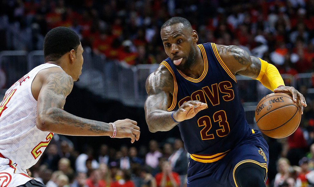 . Cleveland Cavaliers forward LeBron James (23) drives against Atlanta Hawks forward Kent Bazemore (24) in the second half of Game 3 of the second-round NBA basketball playoff series, Friday, May 6, 2016, in Atlanta. (AP Photo/John Bazemore)