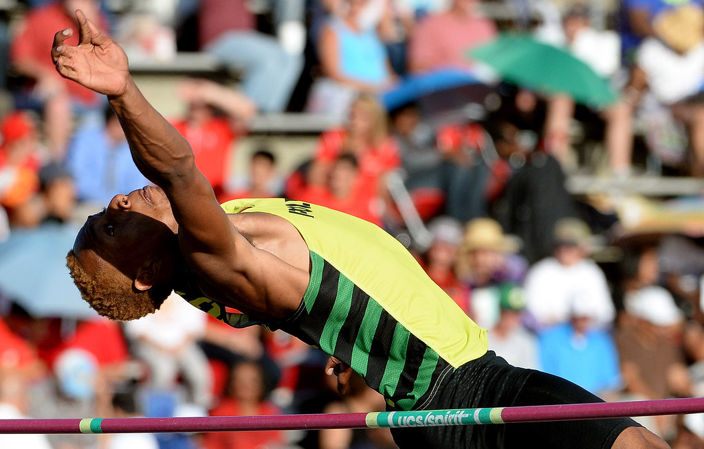 . Long Beach Poly\'s LaBrice Howard competes in the high jump during the CIF-SS Masters Track and Field meet at Falcon Field on the campus of Cerritos College in Norwalk, Calif., on Friday, May 30, 2014.   (Keith Birmingham/Pasadena Star-News)