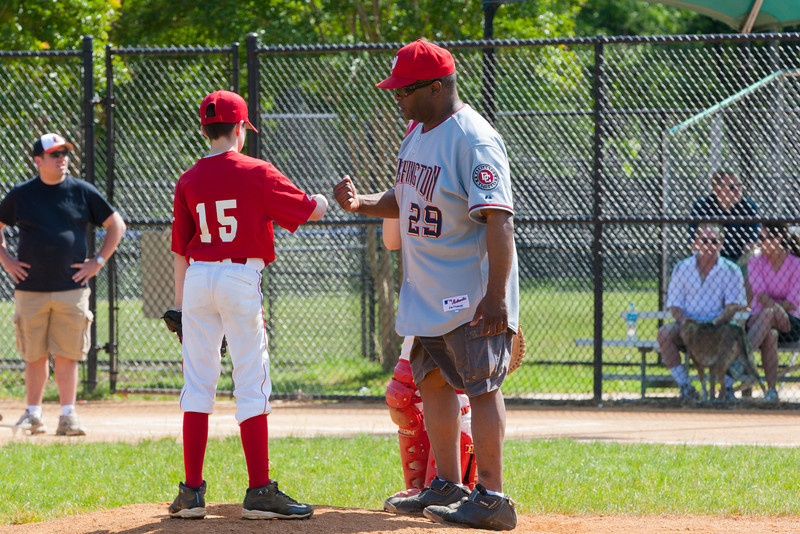 Coach Coop talks to Mac after a bases loaded walk in the top of the 2nd inning. Nats trail 0-3. The Nationals struggled on both offense and defense in a 2-11 loss to the Orioles. They are now 7-4 for the season. 2012 Arlington Little League Baseball, Majors Division. Nationals vs Orioles (19 May 2012) (Image taken by Patrick R. Kane on 19 May 2012 with Canon EOS-1D Mark III at ISO 400, f11.0, 1/200 sec and 210mm)