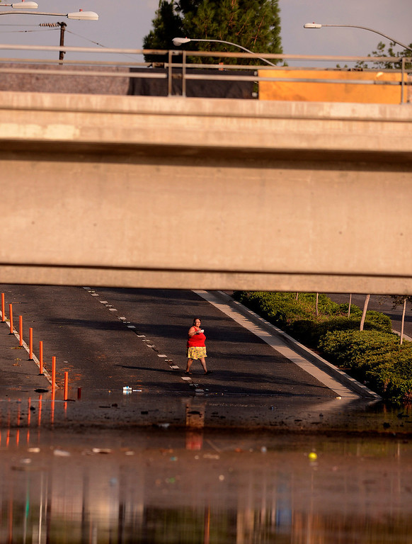 . The intersection of Fourteenth and Vine Streets were closed due to flooding near the 91 freeway in Riverside August 29, 2013.    GABRIEL LUIS ACOSTA/STAFF PHOTOGRAPHER.