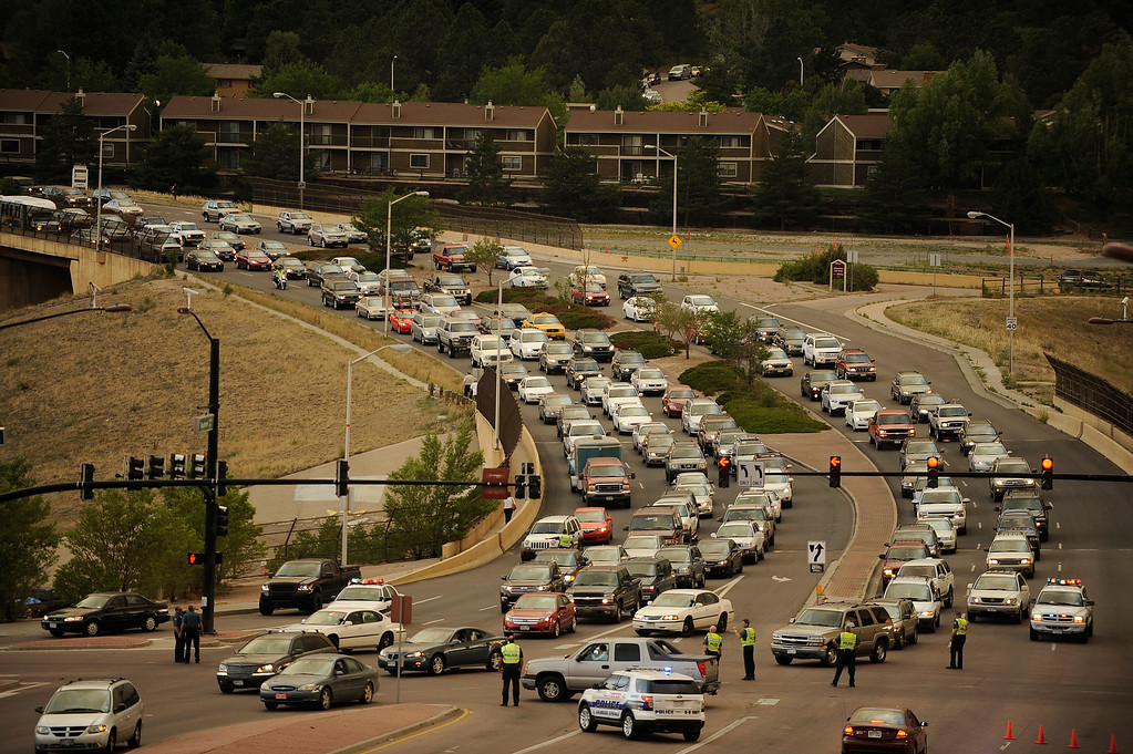 . A traffic jam of cars fleeing the city heads east on both sides of Woodmen Road. The road is closed to westbound traffic. Helen H. Richardson, The Denver Post