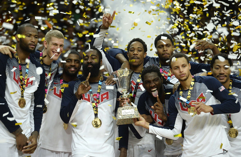 . US players pose with their gold medals and the trophy after winning the 2014 FIBA World basketball championships final match USA vs Serbia at the Palacio de los Deportes in Madrid on September 14, 2014. USA won the match 129-92.  GERARD JULIEN/AFP/Getty Images