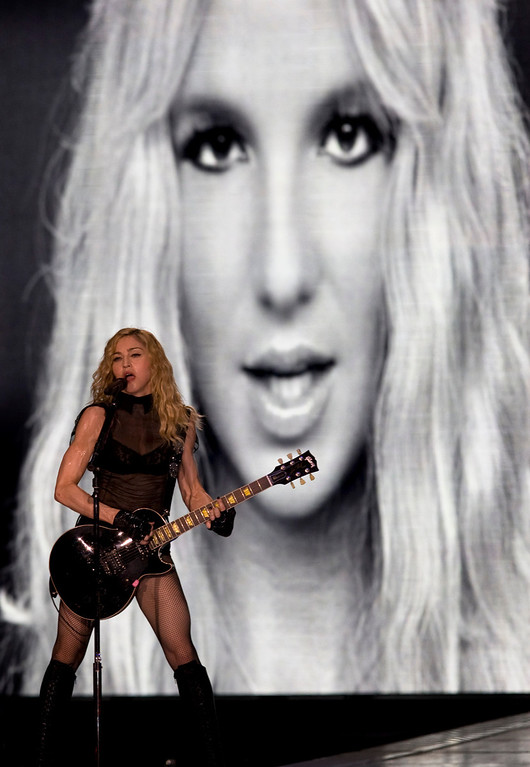 . U.S. singer Madonna performs during her concert in Tel Aviv, Israel, Tuesday, Sept. 1, 2009. The concert is part of Madonna\'s Sticky and Sweet Tour. (AP Photo/Sebastian Scheiner)