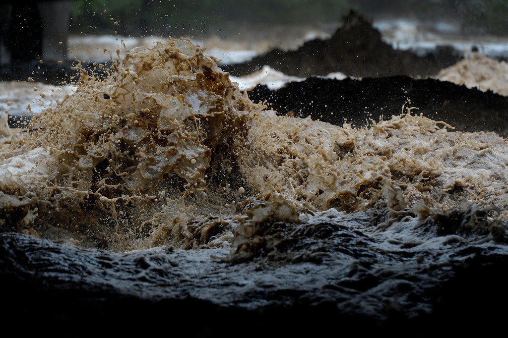 . BOULDER, CO. - SEPTEMBER12: Boulder Creek rages under 28th Street in Boulder CO September 12, 2013. Record-breaking rain turned normally quiet creeks into raging, brown torrents that swept through Boulder on Thursday, flooding homes, swamping cars and closing roads and schools. (Photo By Craig F. Walker / The Denver Post)