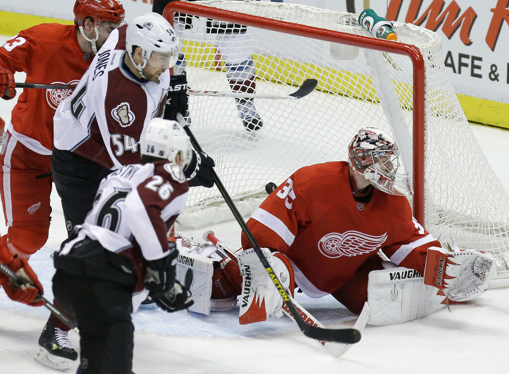 . Colorado Avalanche center Paul Stastny (26) scores on Detroit Red Wings goalie Jimmy Howard (35) during the third period of an NHL hockey game in Detroit, Tuesday, March 5, 2013. Detroit won 2-1. (AP Photo/Carlos Osorio)