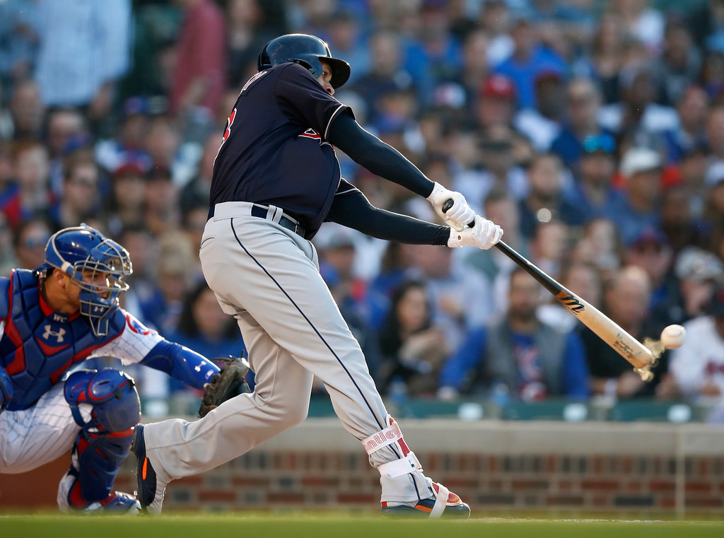 . Cleveland Indians\' Michael Brantley hits a single during the first inning of the team\'s baseball game against the Chicago Cubs on Wednesday, May 23, 2018, in Chicago. (AP Photo/Jim Young)