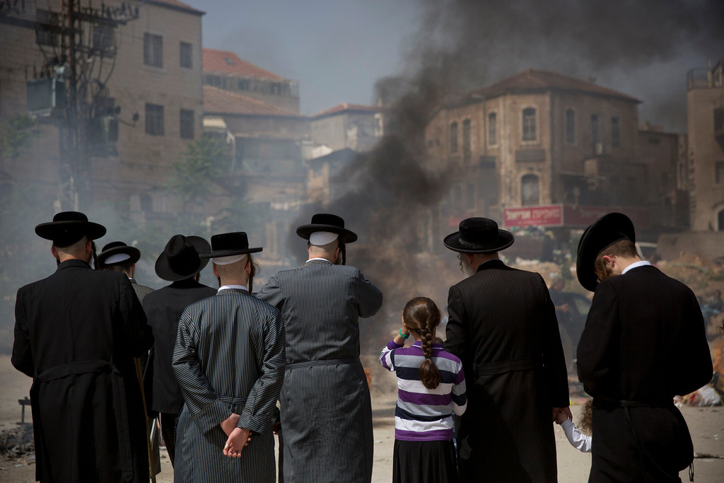 . Ultra-Orthodox Jewish men and children burn leavened items in final preparation for the Passover holiday in Jerusalem, Friday, April 22, 2016. Jews are forbidden to eat leavened foodstuffs during the Passover holiday that celebrates the biblical story of the Israelites\' escape from slavery and exodus from Egypt. (AP Photo/Oded Balilty)