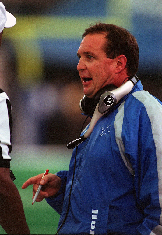 . Detroit Lions Head Coach Marty Mornhinweg talks with an official during Sunday\'s 27-24 loss to the Tennessee Titans at the Silverdome.