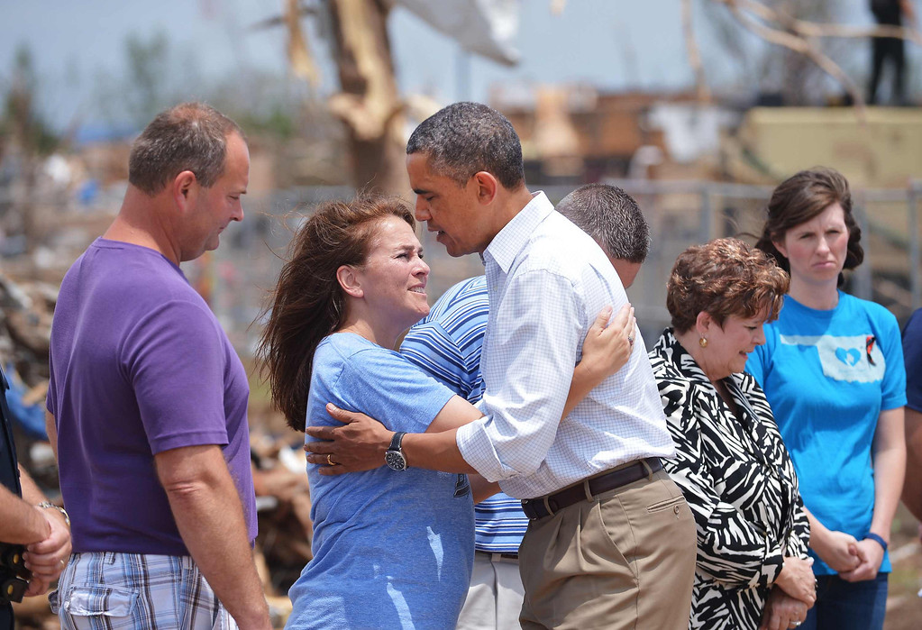 . US President Barack Obama hugs Briarwood School Principal Shelley Jacques McMillian during a tour of the tornado affected Plaza Towers Elementary School on May 26, 2013 in Moore, Oklahoma. Obama is in the Oklahoma City area to survey damage from the tornado which struck a week ago and meet with victims and first responders.     MANDEL NGAN/AFP/Getty Images