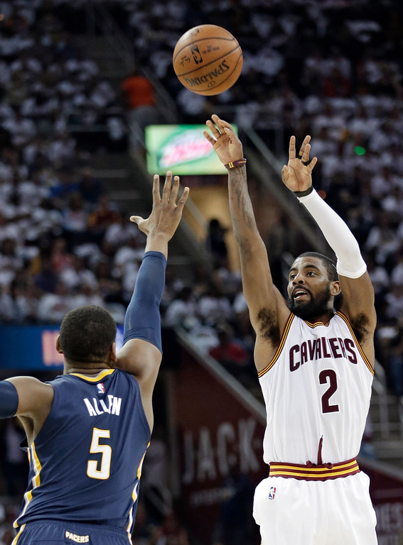 . Cleveland Cavaliers\' Kyrie Irving (2) shoots against Indiana Pacers\' Lavoy Allen (5) in the first half in Game 1 of a first-round NBA basketball playoff series, Saturday, April 15, 2017, in Cleveland. (AP Photo/Tony Dejak)