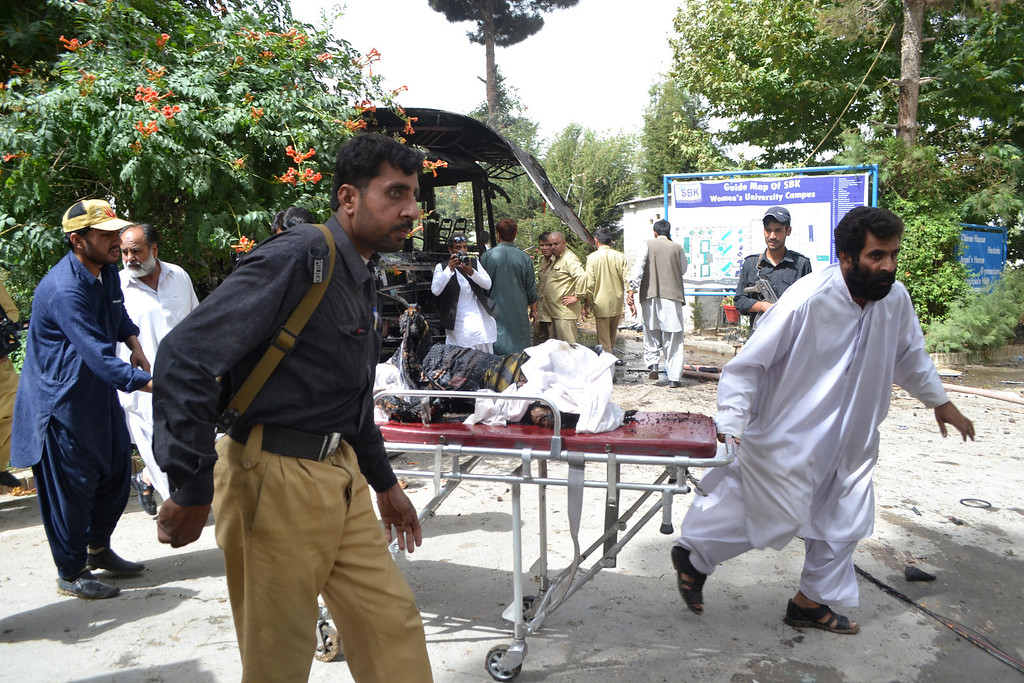 . Pakistani security personnel remove a dead boy after a bomb blast in a  university bus in Quetta, the capital of Baluchistan province, on June 15, 2013.   AFP PHOTO/ Banaras  KHAN/AFP/Getty Images