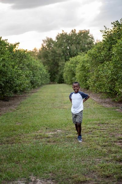 Jayden in orange grove 3.2019.jpg