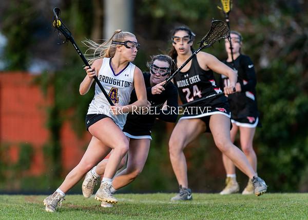 Broughton girls varsity lacrosse vs Middle Creek. February 28, 2020. D4S_0683