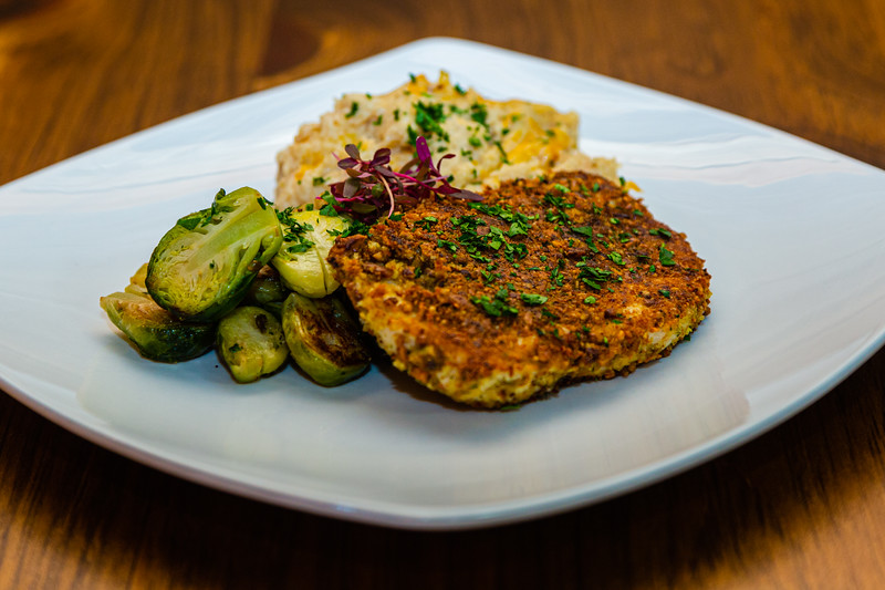 Pistachio and cauliflower chicken, with sides of cauliflower mashed potatoes and roasted brussel sprouts, one of the many dishes at the Hangry Kitchen, located at 2660 PGA Blvd., in Palm Beach Gardens on Tuesday, November 19, 2019. [JOSEPH FORZANO/palmbeachpost.com]
